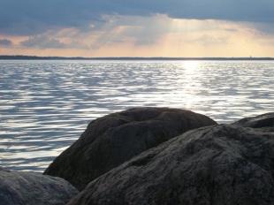 sky over jetty rocks